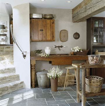 love the natural medium woods against the light grey walls, and slate tile floors
