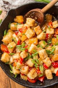 Better than takeout and almost as easy! This sweet and sour tofu is made with crispy tofu in a tangy pineapple sauce with red bell pepper chunks. #tofu #veganrecipe #vegandinner