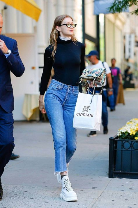 Image ofGigi Hadid Looks Casual Chic Wearing Blue Re/Done Cropped Jeans Over a Black Bodysuit as She Steps Out to Lunch at Cipriani Restaurant Ahead of Her CFDA Awards Red Carpet Appearance.