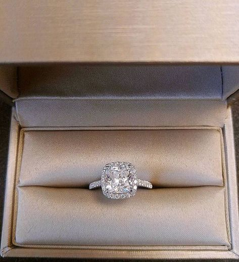 She will love this beautiful and traditional cushion cut halo set engagement ring, with a 3 carat cushion cut center man made diamond and round side diamonds. The side diamonds are set in a single row Wedding Ring Cushion, Engagement Rings Cushion, Dream Engagement Rings, Cushion Ring, Vintage Engagement Rings, Solitaire Engagement, Solitaire Rings, Box Cushion, Anillo De Compromiso