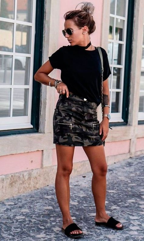 There are a hundred great ways to wear the mini skirt trend. Camille Callen is edgy and original in this camo print skirt with zip detailing, paired simply with a black tee and flats.