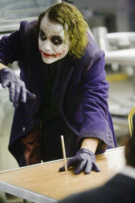 """THE DARK KNIGHT """"Wanna see a magic trick? Now you see it, *Slams head down* Now you dont"""