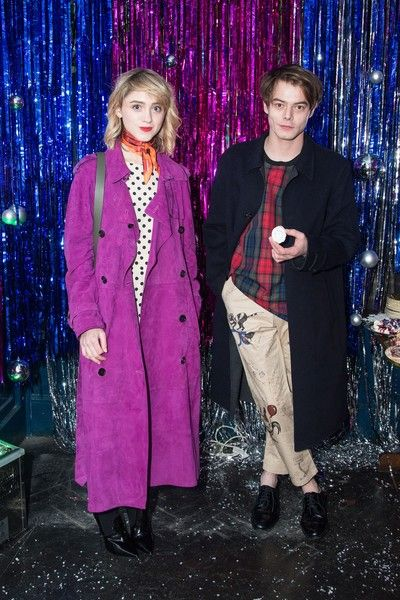 Natalia Dyer and Charlie Heaton attend the Burberry x Cara Delevingne Christmas Party in London.