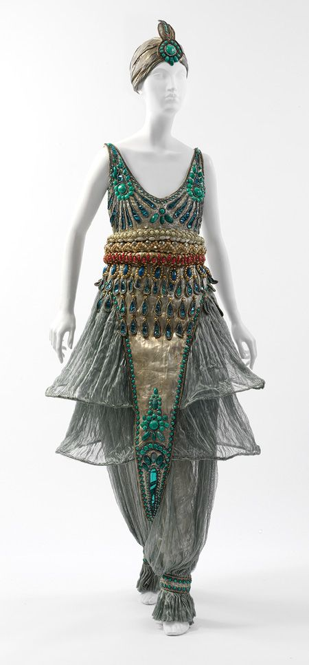 Fancy dress costume, 1911  Paul Poiret (French, 1879–1944)  Seafoam green silk gauze, silver lamé, blue foil and blue and silver coiled cellophane cord appliqué, and blue, silver, coral, pink, and turquoise cellulose beading