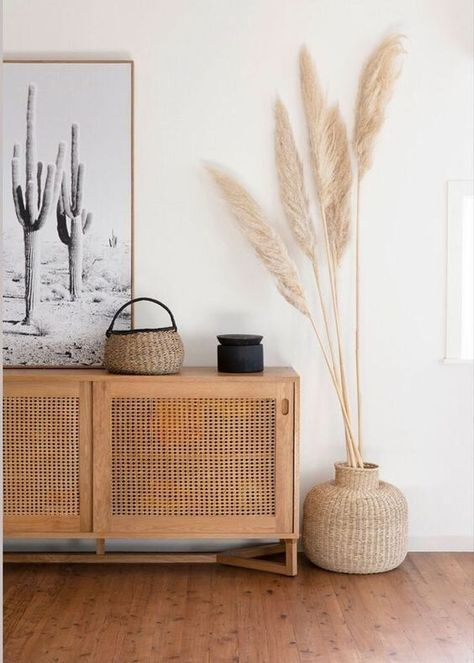 Love this hallway with its desert boho vibes - all you need is pampas grass and a rattan cupboard