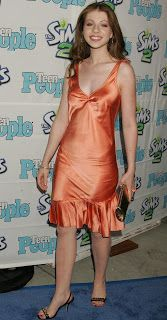 Ladies in Satin Blouses: Michelle Trachtenberg - orange satin dress