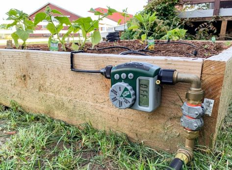 How to install a DIY drip irrigation system in raised garden beds. This guide will show you how to design, build / install, and setup a micro drip watering system with emitters & a programmable timer to automate your garden watering schedule. Drip Watering System, Garden Watering System, Watering Raised Garden Beds, Automatic Watering System, Raised Garden Beds Irrigation, Automatic Irrigation System, Drip Irrigation System Design, Drip System, Irrigation Systems