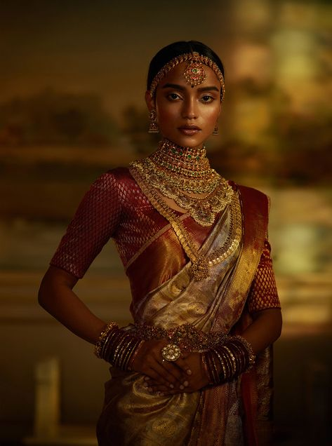 A classic Sabyasachi Kanjeevaram silk saree woven by the master weavers of Kanchipuram with hand-embroidered border. The look is accessorised with traditional South Indian temple jewellery in gold embedded with emeralds, rubies and pearls. South Indian Blouse Designs, Girl Pose, Indian Aesthetic, Tips Belleza, Black Women Hairstyles, Bridal Looks, Indian Bridal, Mannequins, Indian Beauty