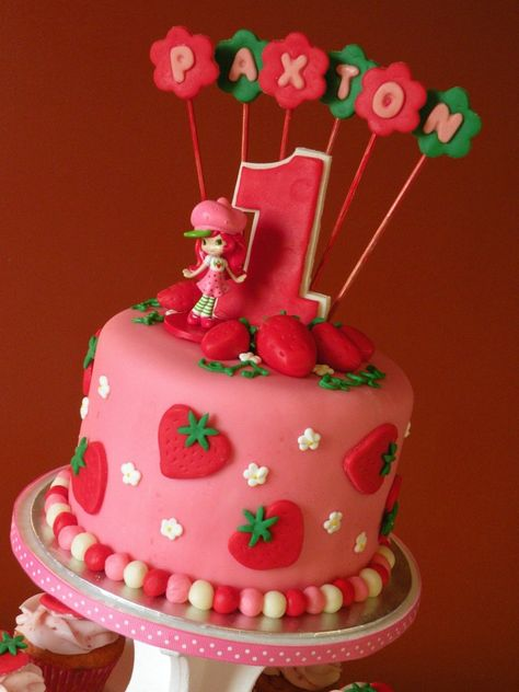 Strawberry Shortcake Birthday Cake & Cupcakes Strawberry shortcake cake and coordinating cupcakes for a birthday.