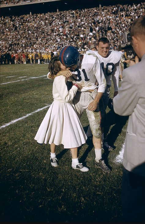 Ole Miss player being kissed by a cheerleader after the team won the Cotton Bowl (1956).