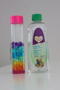water beads A rainbow sensory bottle that is beautiful to look at and fun to enjoy. This bottle was inspired by the separation that occurs when you mix water and oil. I found myself wondering, well, wha Calm Down Jar, Calm Down Bottle, Infant Activities, Activities For Kids, Crafts For Kids, Babysitting Activities, Motor Activities, Sensory Bags, Sensory Play