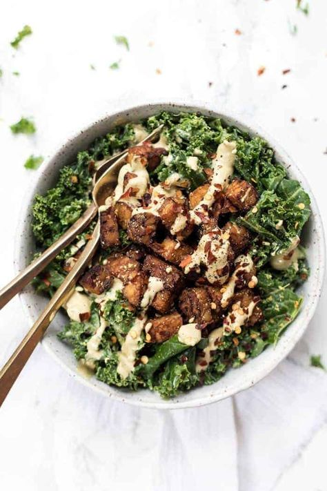 This CREAMY KALE SALAD is tossed with a spicy vegan dressing and smoky baked tempeh to act like gluten-free croutons! [VEGAN & GF] #kalesalad #creamydressing #creamykale #healthysalad #tempeh #bakedtempeh #glutenfree #simplyquinoa