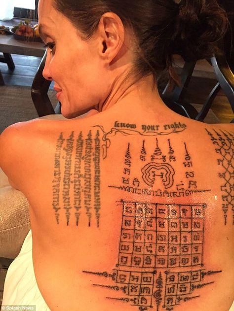 Angelina Jolie being tattooed by ex Thai monk Ajarn Noo Kanpai alongside her husband Brad Pitt in Siem Reap in Cambodia early 2016