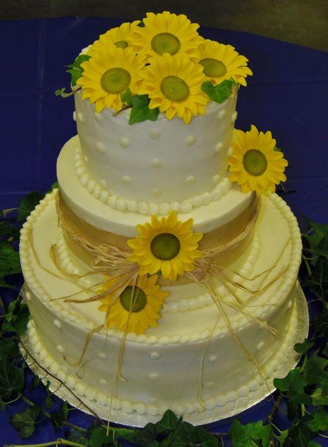 wedding cake I decorated with gumpaste sunflowers. All buttercream decor set-up in Abingdon, Va.