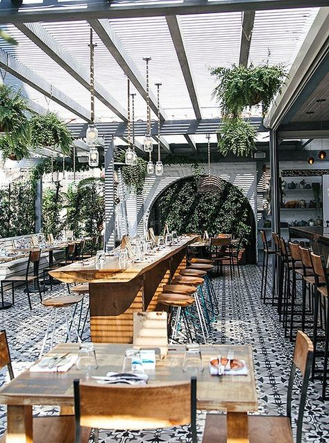 The Outpost Has An Airy Indoor Outdoor Vibe With Arched Doorways And Plenty Of Lush Greene Outdoor Restaurant Patio Restaurant Patio Outdoor Restaurant Design