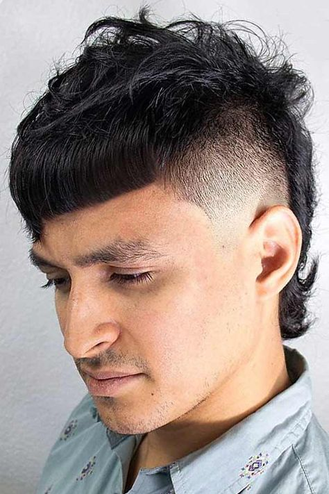 Faded Mullet Haircut #mullet #mullethaircut A mullet haircut has made a huge comeback recently. It has set off many modern male haircuts in mens fashion of 2019. From a short curly Mohawk to an edgy and hot long Asian haircut, there is a style for everybody. #menshaircuts #menshairstyles