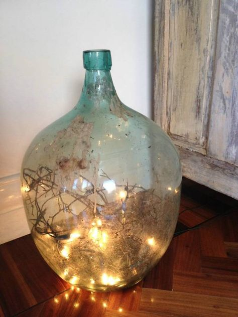 Demijohn bottle with twigs and fairy lights
