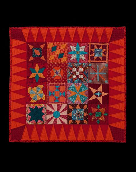 """Dear Jane - Your Stars Are Over New Mexico"" Beaming bright color radiate the ""1863 Dear Jane"" blocks to make a spectacular wall hanging; hand appliqued and quilted. Hand quilted. Size: 25"" x 25"".  MD Anderson auction."