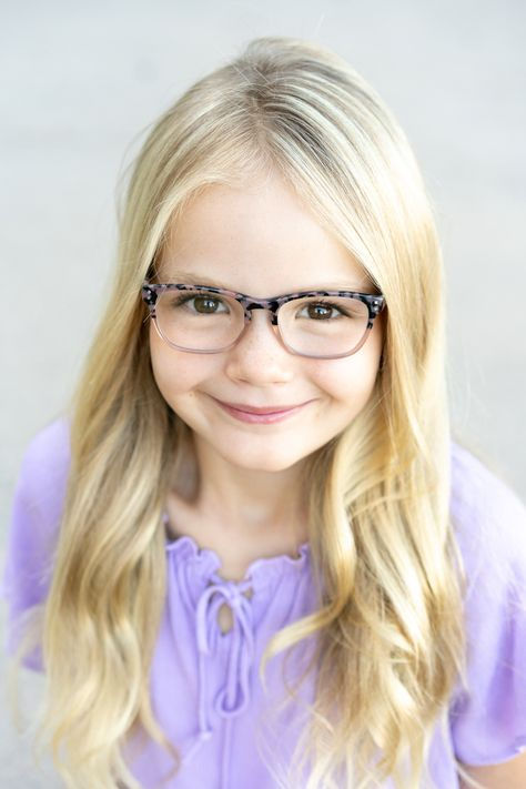 The Lauren/Lincoln frame, a blend of cat eye and rectangle shapes, is available in traditional and trendy colors to create the perfect recipe for success. || Shop for stylish, fashionable boy and girl children's prescription glasses online today. #kidsglasses #jonaspauleyewear