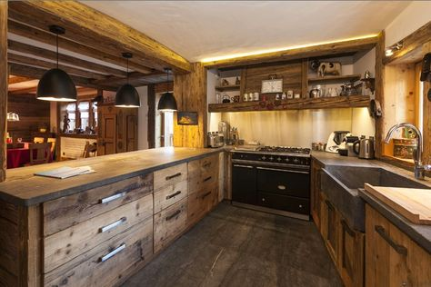 Rustic Chalet Kitchen....but lighten up the floor? Limestone colored tile?