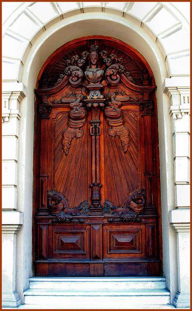 Heavily carved wooden door.