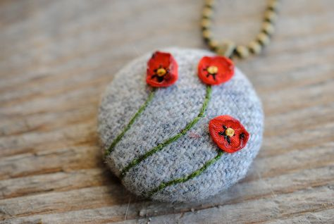 Woodland Holiday Poppy Necklace, gray wool with red embroidered flowers,. $30.00, via Etsy.