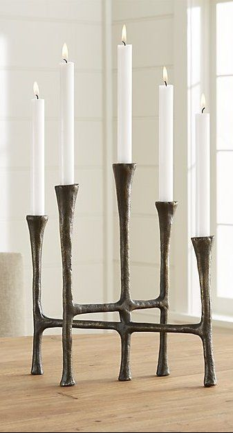 The Iron Age Meets The Modern Era In The Sophisticated Simplicity Of This Sculptural Centerpiece Antiqued And F Candle Stick Decor Candle Holders Floor Candle