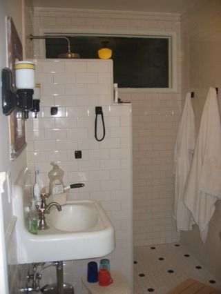 Door less shower for smaller bath. I like the shorter wall bc it makes the space feel more open