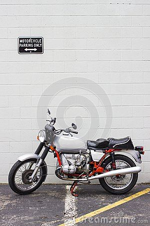 A Picture Of A Vintage Motorcycle Parked In A Motorcycle Parking