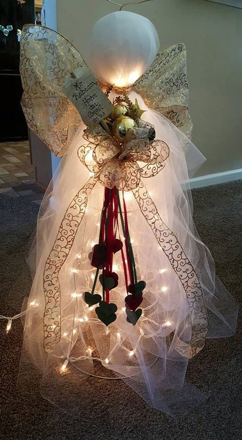 Lighted Angel made from tomato cage; dont let this item fool you, This is not only meant for the winter holiday season! We can adjust this angel to suite your color needs for any time of the year! You can choose to have a message added, or even turn this into a family tree (Last name, with Names and