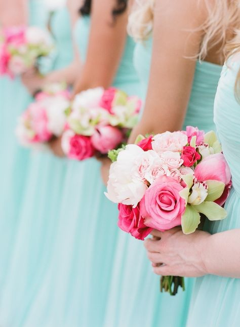 #donnamorgan lovely with pops of bright pink. Bridesmaid Dresses: Donna Morgan - donna-morgan.com, Photography: Jana Morgan Photography - janamorgan.com Read More: http://www.stylemepretty.com/destination-weddings/2014/10/10/whimsical-maui-destination-wedding-at-merrimans/