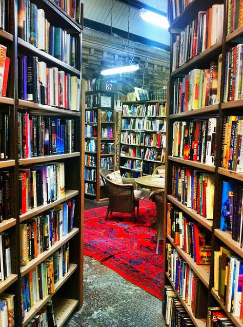 Barter Books in Alnwick, Northumberland. One of the biggest second-hand book shops in Britain! Free tea and coffee next to a roaring fire plus a cafe further inside that serves food. Yum. Used to be an old railway station. One of my favouritest places to browse for old books :)