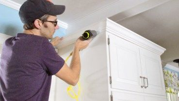 How To Install Crown Molding Yourself With Video Young House Love Crown Molding Kitchen Crown Moulding Kitchen Cabinets Young House Love