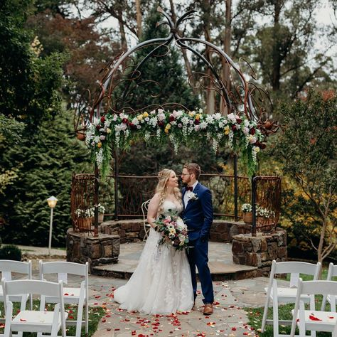 ❤️ This beautiful couple beneath our floral arrangement on the outdoor cupola @tatra_receptions ❤️ Ask us about styling your ceremony today . . . . . . . . . #melbourneweddingdesigners #weddingstylist #weddingstyling #beautiful #justmarried #brideandgroom #floraldesign #floralarrangement #floralstyling #weddingdecor #wedding #eventstyling #weddingday #mtdandenongweddings #love #flowers #weddingflowers