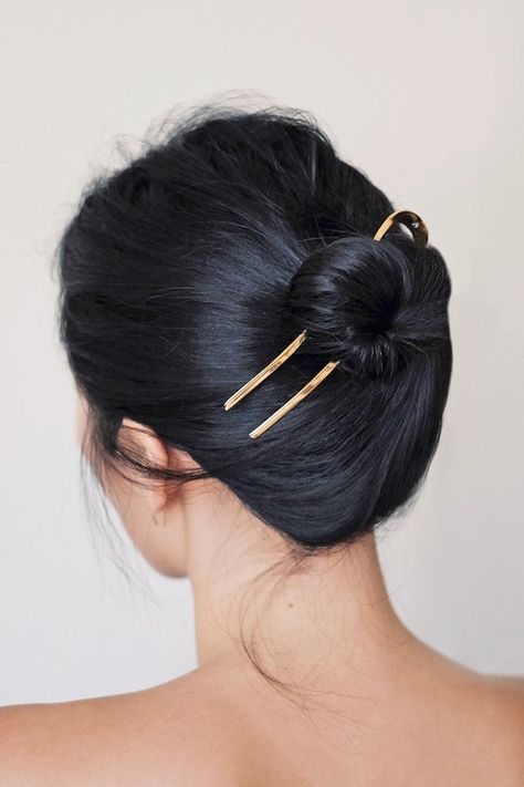 Hair accessories don't always have to make a loud statement. There are plenty of options for the minimalist that are understated while still being able to turn heads. Enter this minimal-cool hair look from Ann Kim of the LA-based blog Andy Heart. Her sleek bun is brought to the next level with a simple, yet stunning gold hair pin that we can't wait to get our hands on.