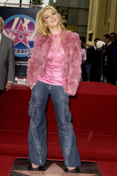 Britney Spears consecrating her star on the Walk of Fame in the early rocking a very chic outfit for the time. Note the cargo-esque flare leg low rise jens and pink fur.
