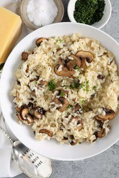 Mushroom risotto is a creamy and delicious side dish that is so easy to prepare. This gourmet looking recipe is packed with flavor made with mushrooms, parmesan, and white wine! #spendwithpennies #mushroomrisotto #sidedish #gourmetsidedish #easysidedish #creamymushroomrisotto
