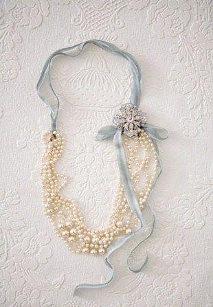Fold beads in half, tie ribbon, add brooch.