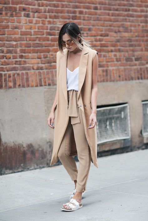 spring / summer - street style - summer outfits - casual outfits - beach outfits - neutral layers - camel sleeveless duster coat + white cami top + silver bar necklace + white flat sandals + camel belted trousers + orange aviators