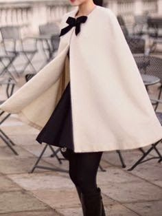 Creme cape with black bow
