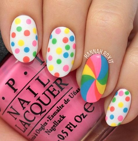 Be preppy and flirty with these cute rainbow polka dots and swirly fun. use lighter shades of the rainbow to make it more appealing on a white nail polish base.
