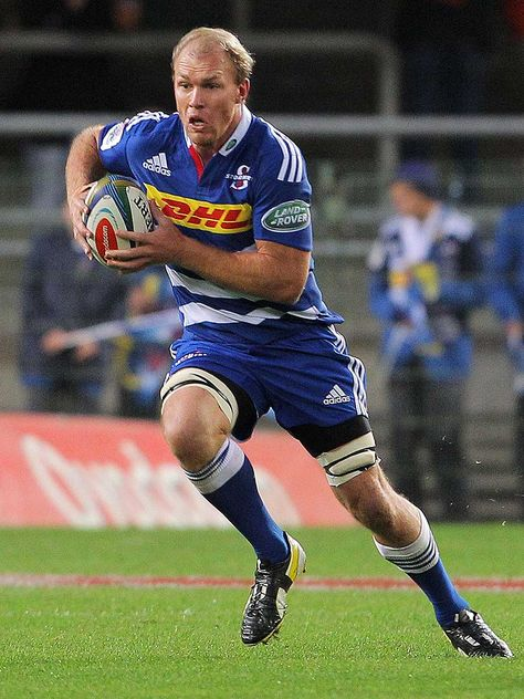 The Stormers' Schalk Burger runs the ball forward