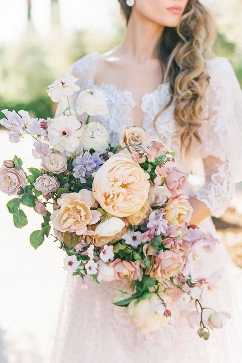 LBB floral designers @bowsandarrowsflowers have blown us away once again…🤯 This bouquet might just be an all time favorite. Bookmark for color palette inspo! | LBB Photography: @laurenfair #stylemepretty #springwedding #summerwedding #weddingbouquet #pastelwedding