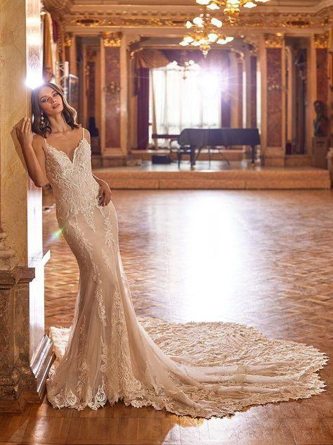 Val Stefani Style Dolce will be love at first sight. This sexy mermaid wedding gown features a deep v-neckline with beaded straps and romantic re-embroidered lace appliques with sequins that will have you falling in love. Glass beds with sequins sparkle along this form fitting style, leaving you looking glamorous as can be. #weddingdress #weddinggown #weddingdressinspiration #weddingdressideas