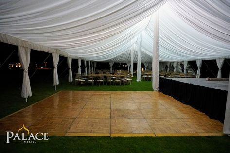 Add a Touch of Elegance to your Wedding or Event with Illuminating Ceiling Draping Canopy Provided by Palace Events! #palaceevents #palaceevent #wedding #event #weddingrentals #eventrentals #weddingreception #tent #tentaccessories #tentcanopy #tentdraping #ceilingdraping #tentwedding #whitedrape #lighting #illuminatinglighting #weddingplanning #eventplanning #weddinginspo #eventinspo #weddingdecor #eventdecor #dancefloor #wooddancefloor #outdoorwedding #countryclubwedding #mattooncountryclub