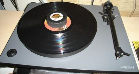 DIY Hockey Puck Record Clamp. I am canadian. And a vinyl lover...
