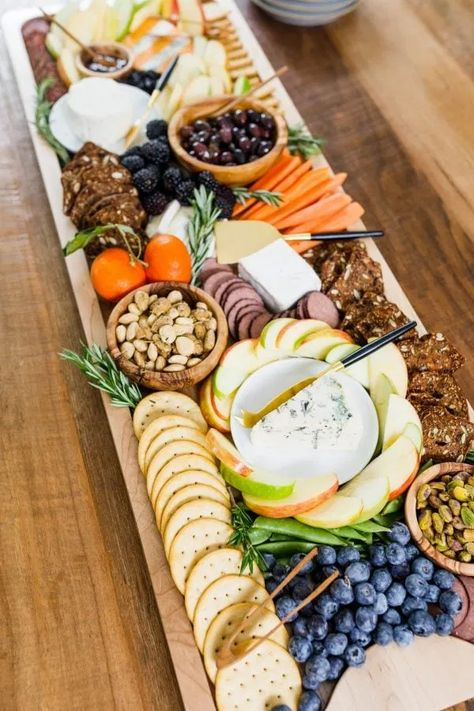 Best Charcuterie Board recipe is a cheese board with meat, cheese, crackers, olives, veggies served on the Reluctant Entertainer BIG BOARD! #charcuterieboard #cheeseboard #reluctantentertainer #thebigboard #thebigboardRE