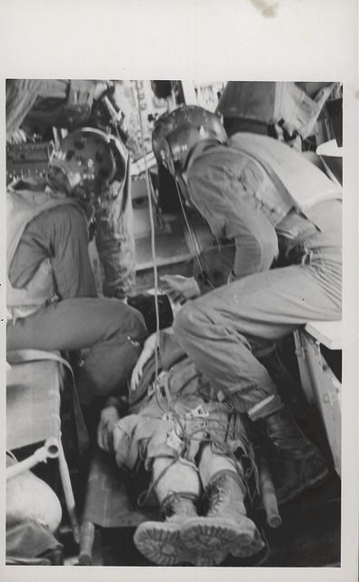 Crew Chief and Corpsman Attend to Wounded Marine, circa 1968