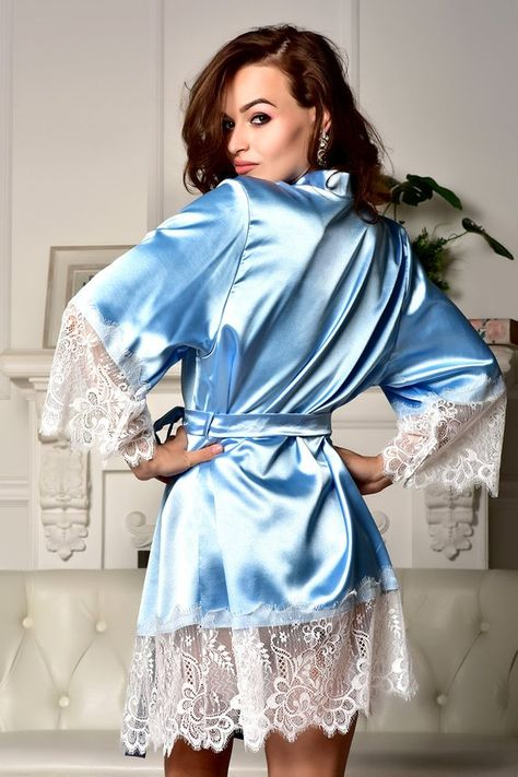 This sexy short blue robe with white lace is made of stretch satin. The  sleeves as well as the hem are trimmed with wide white Chantilly lace. 671b7354f