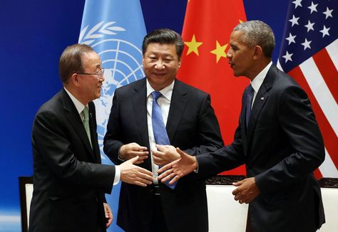 Chinese President Xi Jinping © shakes hands with US President Barack…